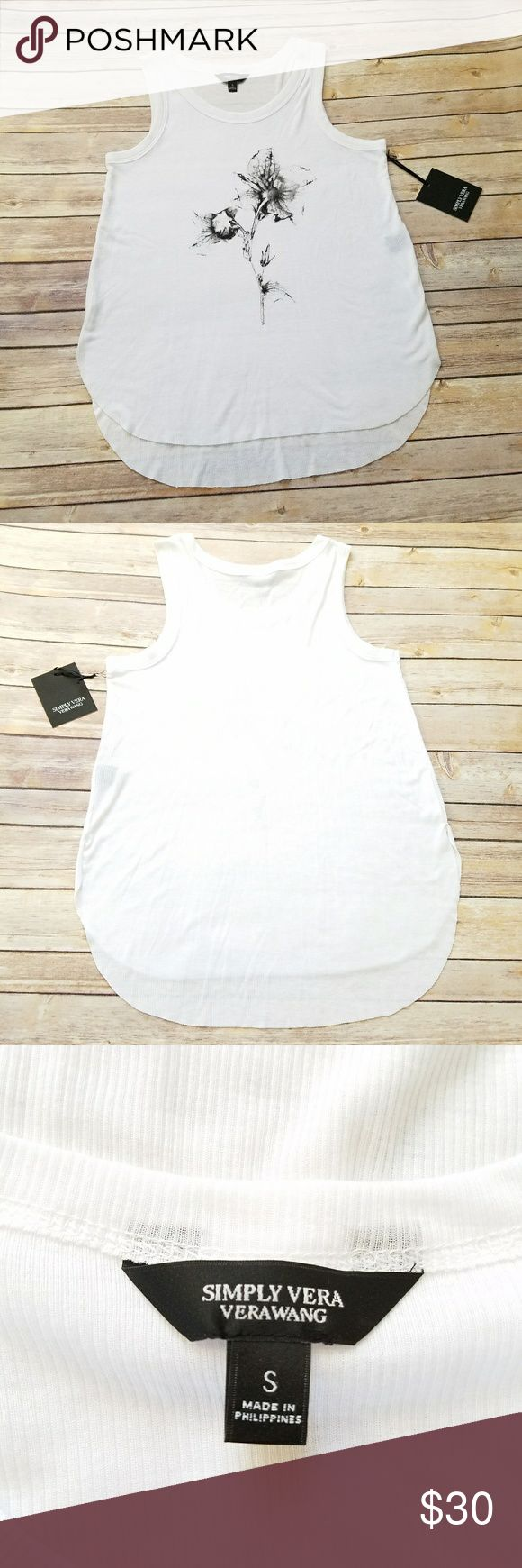 NWT Simply Vera Wang white ribbed tank top Size Small. - bust 17.5 in underarm to underarm - length 23.5 in in front, 26 in in back Simply Vera Vera Wang white ribbed tank top with a flower graphic on the front. New with tags! Simply Vera Vera Wang Tops Tank Tops