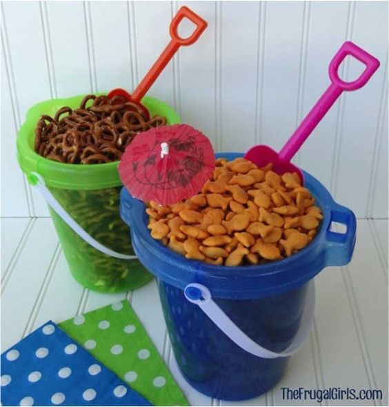 For a beach-themed party, keep snacks in buckets and use a toy shovel as a scoop.: