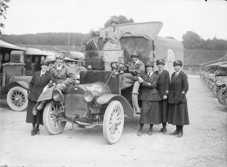 MINISTRY INFORMATION FIRST WORLD WAR OFFICIAL COLLECTION (Q 2438)   A group of female motor ambulance drivers from the Voluntary Aid Detachment (VAD) with their vehicle, a Canadian Red Cross ambulance, at Etaples, France, on 27 June 1917.