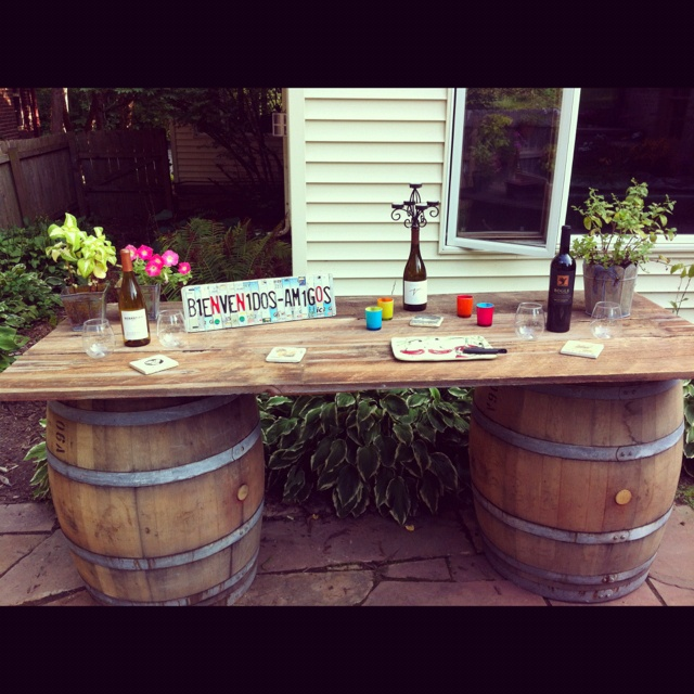 My new DYI wine barrel table using reclaimed wine barrels and salvaged barn boards for the table top.