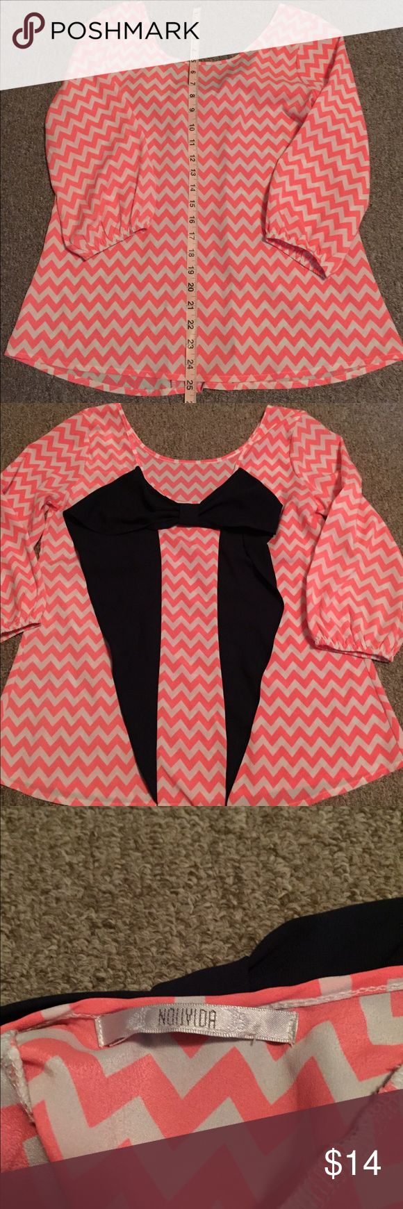 Pink chevron shirt with navy bow Pink Chevron shirt with a back navy bow🎀this top is adorable 😍 attached is pictures of the front and back, and also the brand. I bought this shirt used, but it does not fit me. 😕 I could not find a size on the tag, I'm assuming it's a small or medium. I can get additional measurements to help out the best I can! Tops Blouses