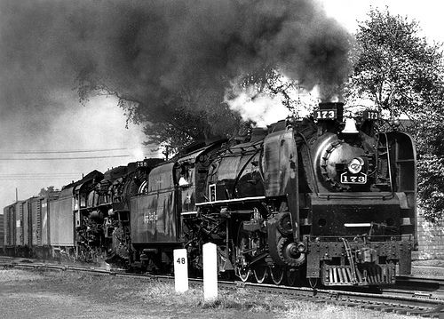 seems I have a thing for trains lately... *Nickel Plate steam locomotives, Brooks class (L1a) 4-6-4 Hudson # 173 & LIMA class (S-2) 2-8-4 Berkshire # 758, seen leading a manifest freight train along mainline near milepost # 48 in Ohio, mid 1950's, photographer unknown, Charles Snyder collection