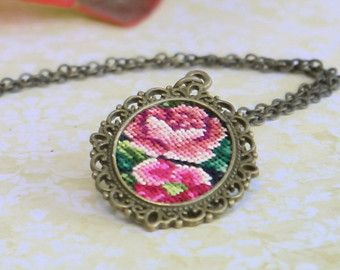 Cross stitch pendant necklace by TessaRandi on Etsy