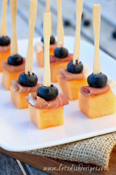 Orange and Blue Broncos Themed Superbowl Party Menu; Canteloupe, Blueberries, and Prosciutto Skewers