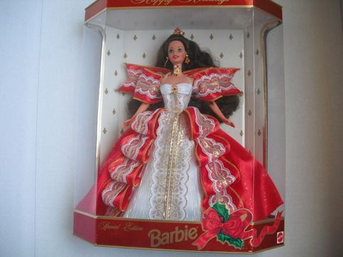 A beautiful 10th Anniversary Happy Holidays Barbie. Wrapped in red ribbons and delicate lace, Barbie is a portrait of holiday grace. Small split on plastic on left side. Unopened box, Thank you so much for visiting my store.