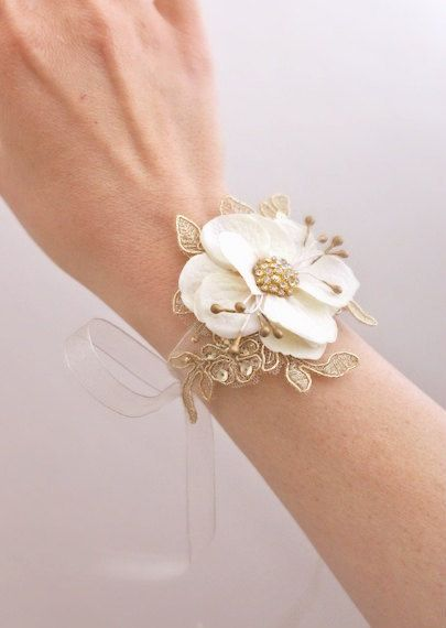 The fabric flowers seem to be more simple than the real flower corsages... anyways, the gold lace is really pretty!