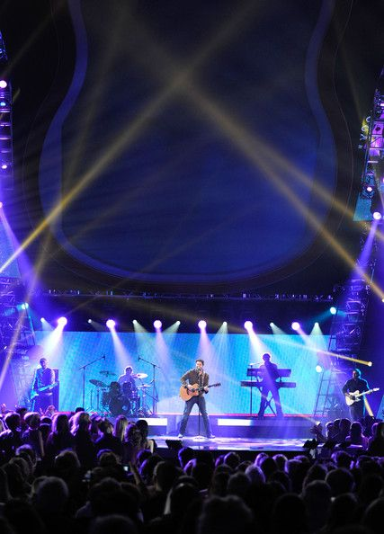chris young country singer | Singer Chris Young performs onstage at the American Country Awards ...