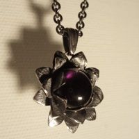 Oxydized silver pendant with large cabuchon amethyst. Handmade by Ailin Roelvaag. #custommade #pendant #silver #amethyst #jewellerydesign