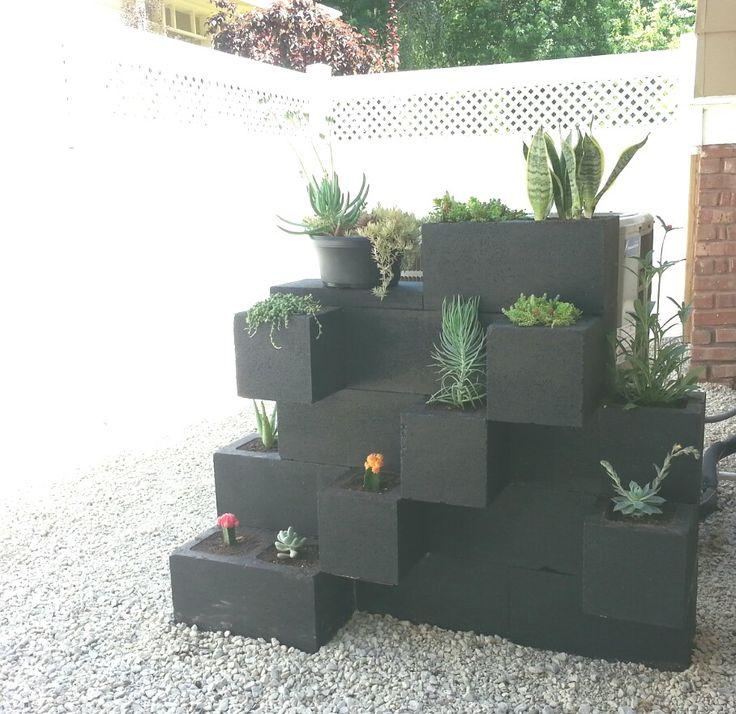 Painted cinder blocks planter. Succulents. Hide air conditioner. Back yard gravel. Dog friendly
