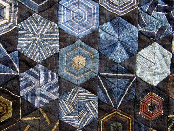 Love the different ways to use stripes in a hex quilt --are they men's shirts?
