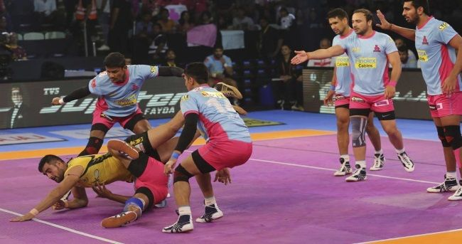 Telugu Titans rode on an outstanding raiding performance by Rahul Chaudhari to beat Jaipur Pink Panthers 41-34 in Inter-Zone contest of the Pro Kabaddi League season 5 at the Thyagraj Stadium here on Wednesday.
