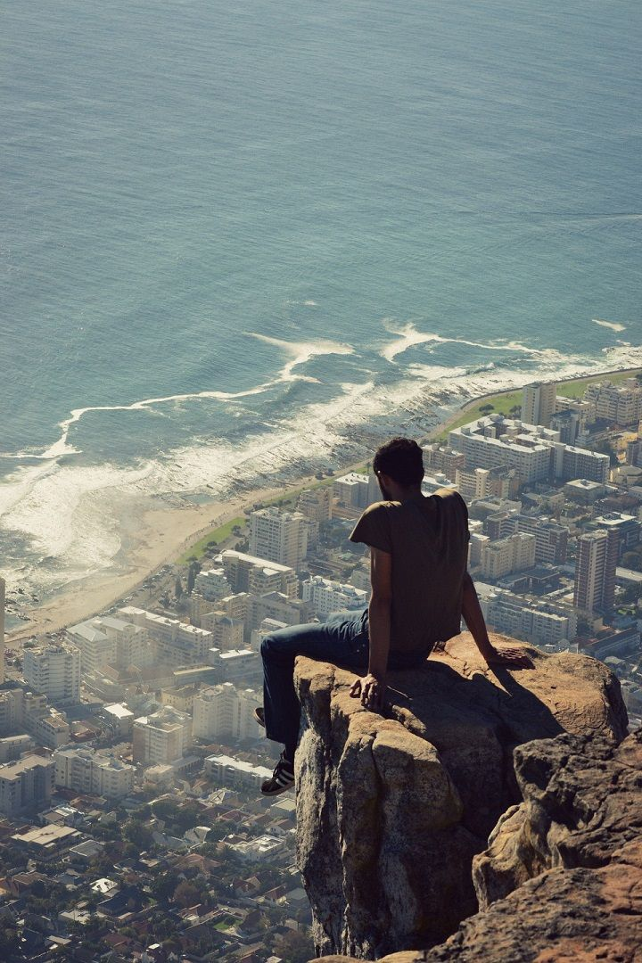 Awesome Picture of a Man Sitting on a Cliff Ledge in Cape Town, South Africa