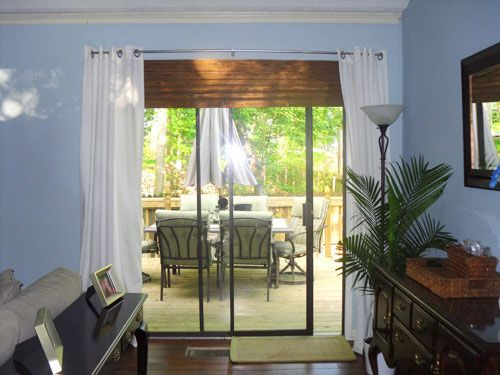 Cheat curtains high and wide.  Pair with Bamboo shade, even on sliding glass door.