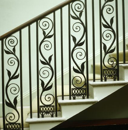 Detail of the cast-iron balustrade on the Staircase with a pattern of scrolls and leaves, and John Ferguson's handrail of mahogany inlaid with ebony