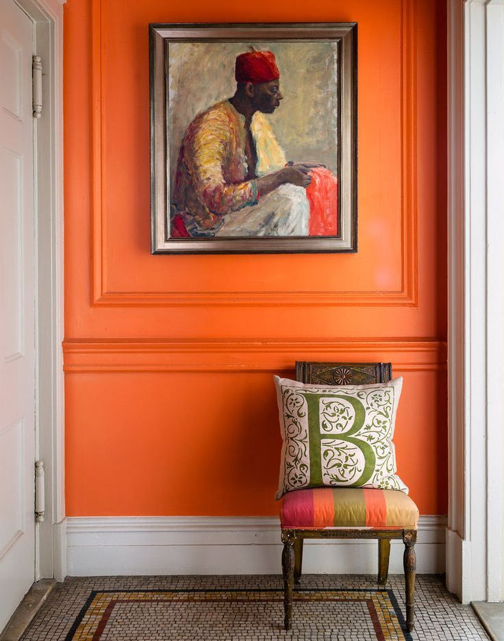 "Farrow & Ball ""Charlottes Locks"" Love the echo of tangerine in the painting, on walls & upholstery on chair. Lovely!"