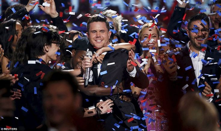 Final winner: Trent Harmon was surrounded onstage by his fellow contestants on Thursday after being crowned the final winner of American Idol at the Dolby Theatre in Hollywood