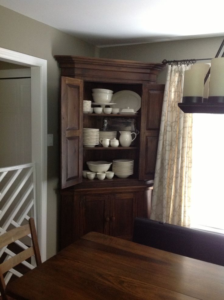 The antique corner cabinet that holds my white dishes in the dining room. From the in-laws, love it!
