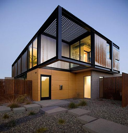 "A stylish addition to the landscape in Tempe, Arizona, this modern house is a stunning site-specific design that seamlessly blends art and entertainment. Work of talented architects from Chen + Suchart Studio, the linear structure completely integrates with the surrounding scenery. With black steel beams and an elegant wooden facade that charms from every angle you look at it, the custom house also manages to ""bury"" a small pool where you can hide from the hot sun. It could be yours for a…"