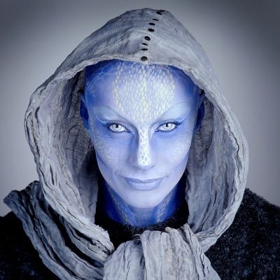 Pa'u Zotoh Zhaan (Virginia Hey) – A bald, blue-skinned female who belongs to a plant-like species, named Delvians. Once a Priestess of her religious order, Zhaan murdered her lover after discovering he was a Peacekeeper collaborator. Regarded as an anarchist by her captors, she was jailed along with D'Argo and Rygel.