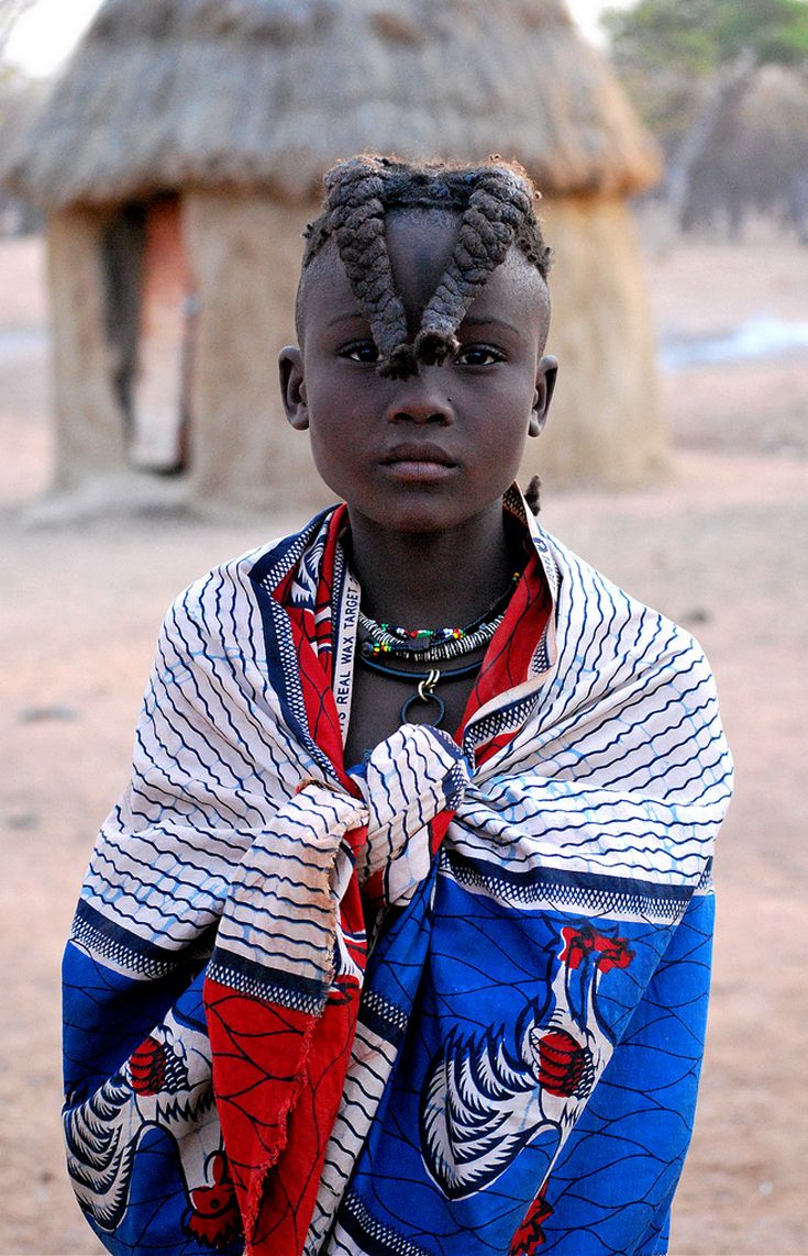 Africa | A young Himba girl.  Namibia | ©Jennyfer Vigue