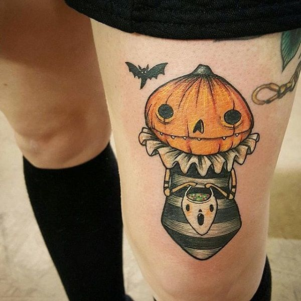 A really quirky and cute looking Halloween tattoo design. The design features a pumpkin that seems to be going out for trick or treating on Halloween which makes it look even cuter.