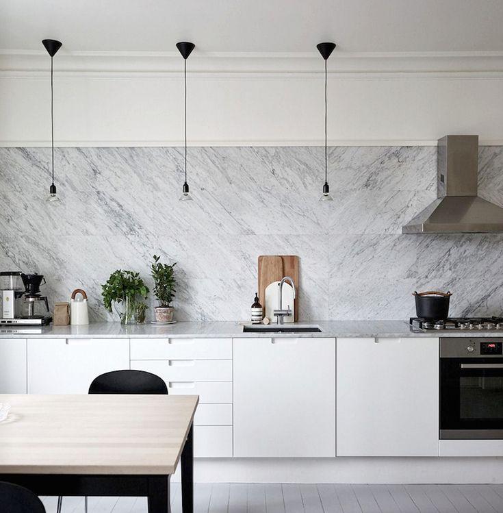 Large marble tile backsplash.