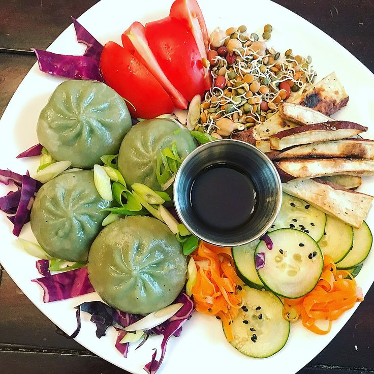 Garden Vegetable Dumplings with Lime Soy Sauce, Quick Pickled Cucumbers & Carrots, Roasted Japanese Yam, Fresh Tomato Slices, Scallions, Purple Cabbage & Sprouted Beans