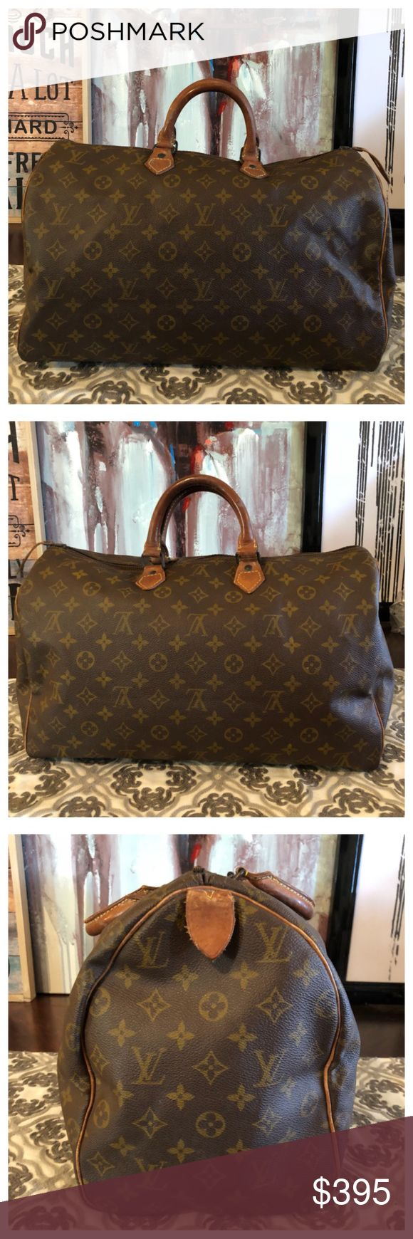 """AUTHENTIC LOUIS VUITTON SPEEDY 40 100% Authentic Louis Vuitton Speedy 40. Monogram canvas has no scratches or tears. Vachetta leather has darkened and shows wear and scratches. Hardware has tarnished. No exposed piping on corners 👍🏼 Zipper works properly. Inside is roomy and in good shape. Minor storage smell. Comes with lock no key. W15.7""""xH10.2""""xD7.4"""" No trades Louis Vuitton Bags Satchels"""