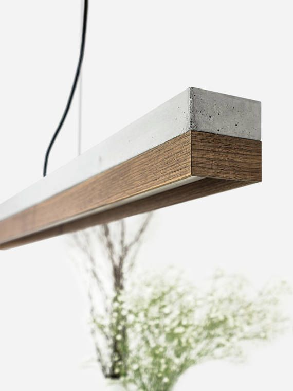 [C1]nut The rectangular pendant lamp [C1]nut is cast from a light grey concrete. It combines modern Nutwood with rough concrete into a timeless and elegant designer lamp. The different materials of the lamp shades can be changed and new combined at every time . With an edge length of 122