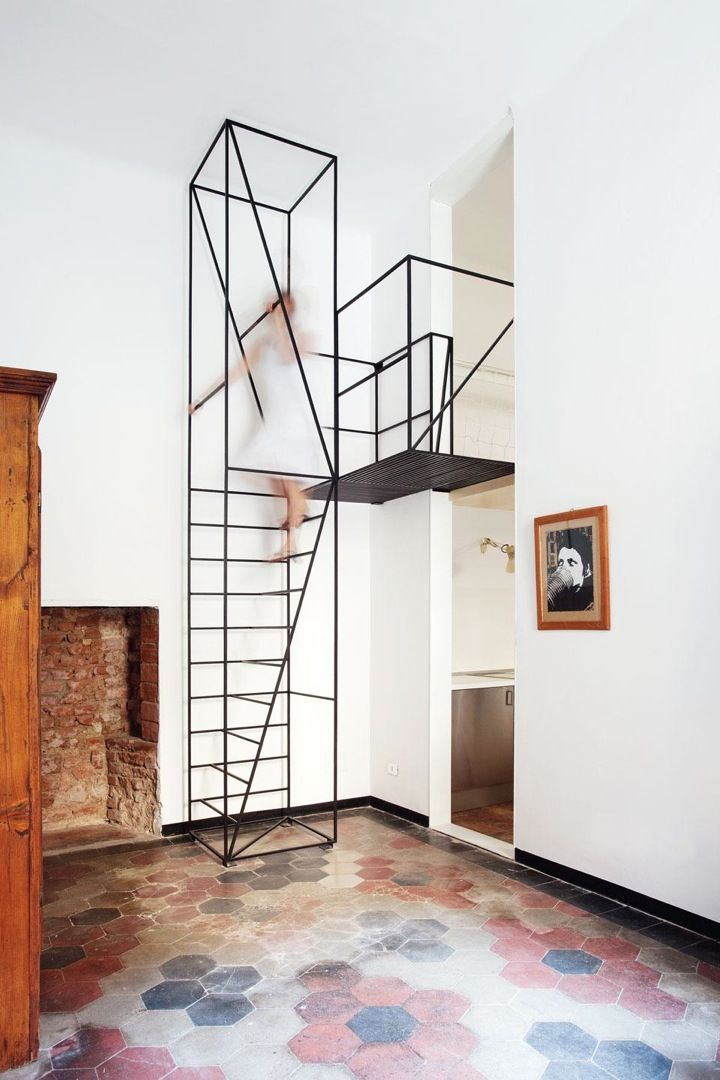 """""""With 'House C.' creative team Francesco Librizzi and Matilde Cassani remodeled an original 1900 house, where windows, doors and tiled floors survived to modernity. The only possible intervention was an almost-2D frame, able to double the space in height and create new possibilities on other layers. Especially the new staircase is in our opinion an eyecatcher and a success in design and function."""""""