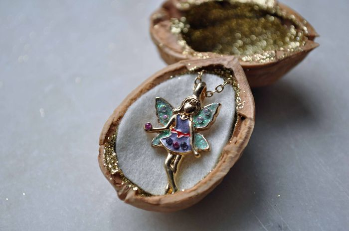 A Necklace Hidden in a Walnut Presents by Curly Birds