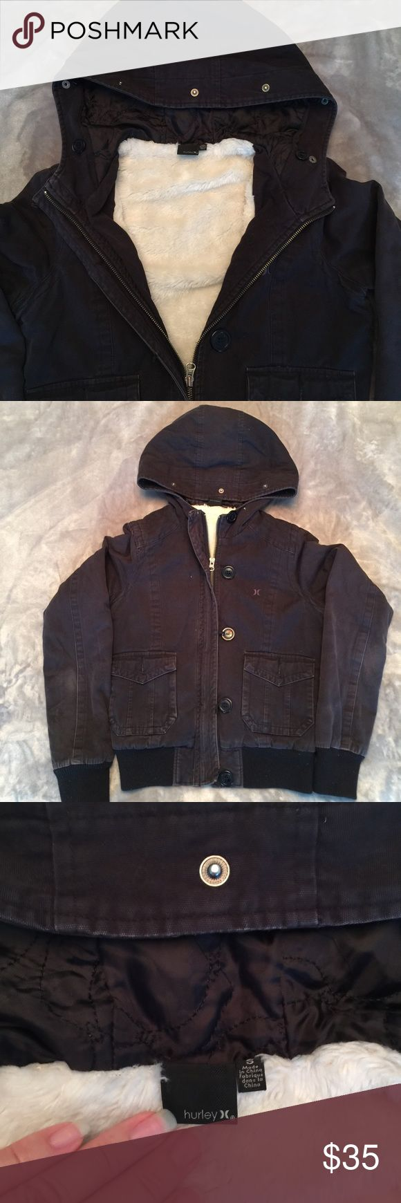 HURLEY Juniors black cotton jacket. Very good used HURLEY Juniors black cotton jacket. Very good used condition. Slight wear on elbows of sleeves. Elastic ribbing on cuffs and waist. Excellent Metal zip and button front with elastic bands to go around buttons. Cozy Fleece Inside excluding sleeves. Very nice med. weight jacket. Previously loved. 😍 Hurley Jackets & Coats Jean Jackets