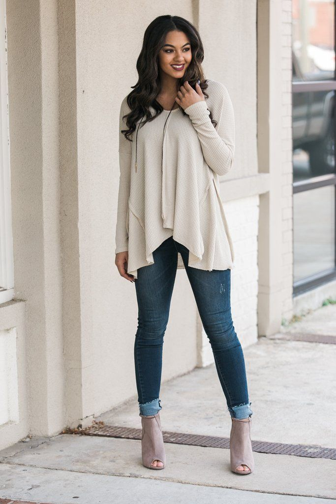The Fray With Me Top in Taupe is proof that casual comfort is always in season! This long sleeved top has a relaxed v neckline, frayed fabric detailing, and a loose fit. The top has a defined hi-lo st