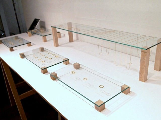 elevated flat glass with small blocks of wood jewelry display ::  shihara…