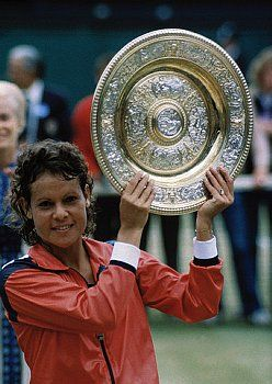Evonne Goolagong Cawley holds her Wimbledon trophy ~ 1980