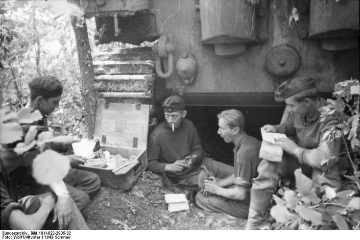 "s.Pz.Abt. 503, the crew of Tiger 323 having completed the job of camouflaging their tank has time to read some letters from home, Operation ""Zitadelle"", July 1943."