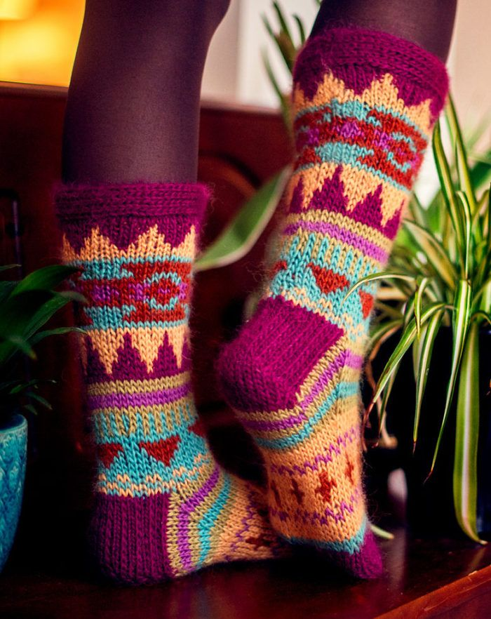 Free Knitting Pattern for Aztec Socks - Colorful socks knit in worsted weight yarn 3 sizesS, M, L. Knit with 6 or more colors, it's perfect for stash or scrap yarn. Designed by Abbyeknits