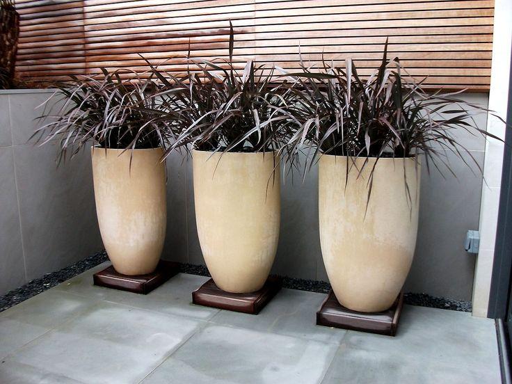 Anthony Paul Landscape Design Planters on ceramic pedestal