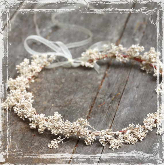 This feminine, airy, and romantic head wreath has fairytale charm. Designed with attention to the dainty details. It features airy sesame bloom, with a long flowing sheer organza ribbon tie.  This piece is so very versatile, it can be adjusted to fit any size head - child to adult, and every girl in between! Its an especially pretty piece for a bride on her big day! Or, a special crown for any lady to wear to a special occasion.  ~Please Note - the second and third photo, show a model…