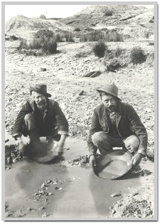 Fossickers at Nerrena in Gippsland Victoria Australia in 1904. The land in the background has been heavily worked by miners and is denuded of timber and most vegetation.