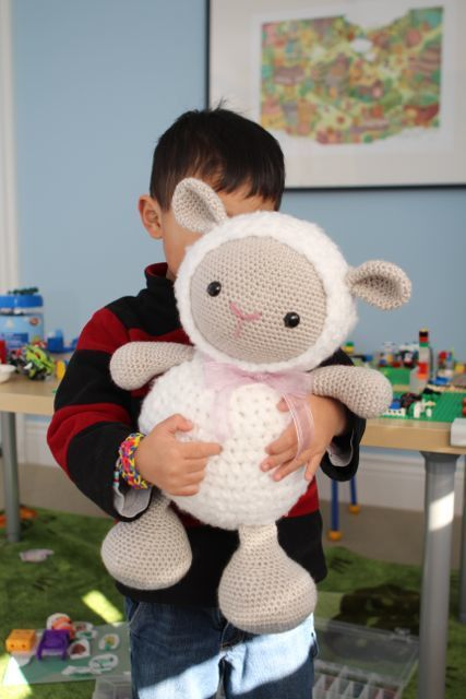 Cuddles is a pretty huge amigurumi! I don't think you can really appreciate how big she really is unless you see her in relation to a little person See how cuddly and soft she looks? Cuddles' pattern by Little Muggles can be found in our new book...