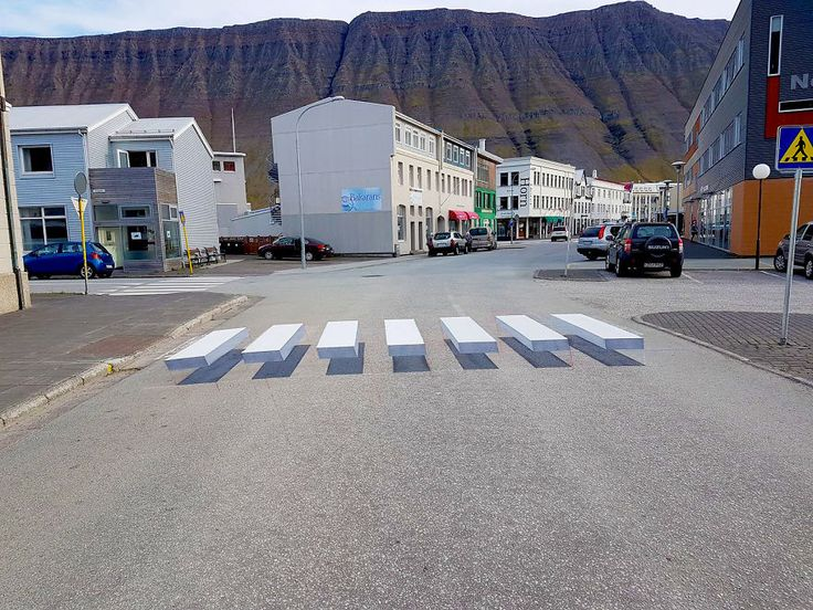 In the small fishing town of Ísafjörður, Iceland, an exciting development in road safety has just popped up - almost literally. A new pedestrian crossing has been painted that appears to be 3D by way of a cleverly-detailed optical illusion.