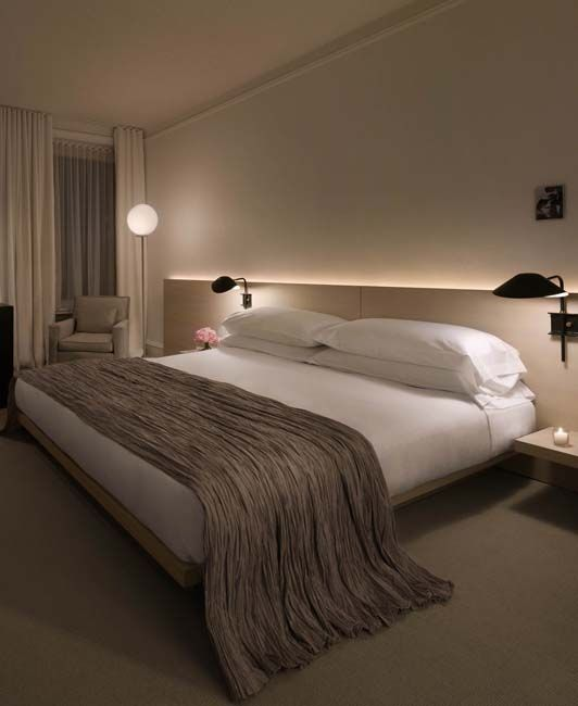 Interesting wall lights as well as the led headboard light make this bed modern and chic.