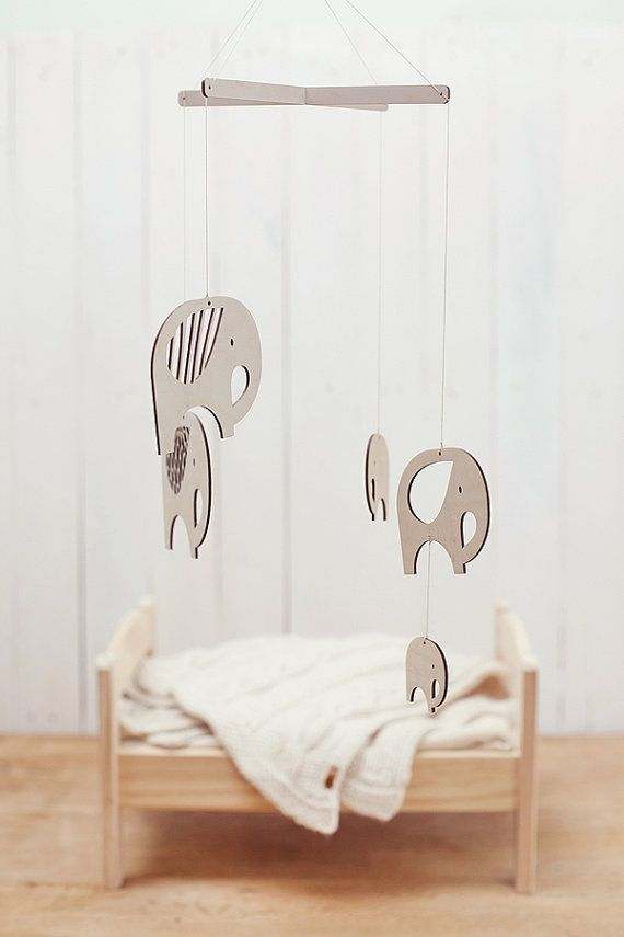 This vintage-inspired wooden baby mobile is a modern addition to any nursery. Flying elephants will guard your little ones dreams and entertain baby