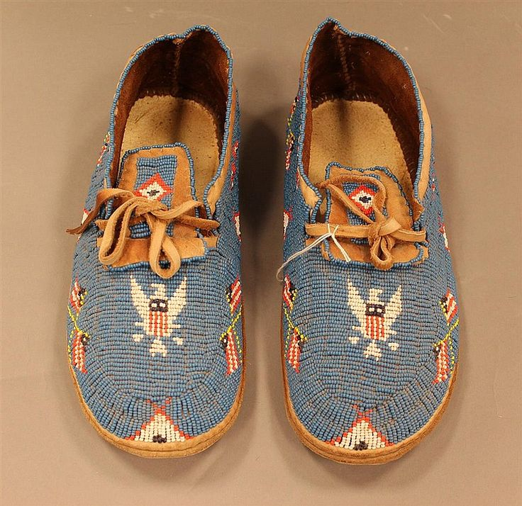 Mocassins, Plains Indian, fully beaded blue with eagle and flags, size 12, circa 1920-1940