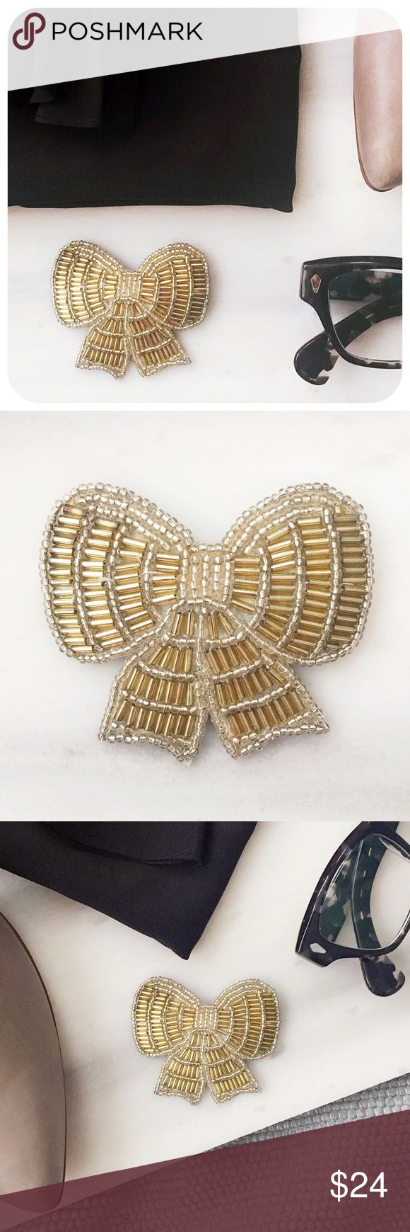 """{{ Vintage }} 1988 Avon Beaded Ribbon Bow Brooch Vintage Avon bow shaped brooch with silver and gold glass seed and bugle beads circa 1980s.   {{ CONDITION }} Excellent - minor scratch on back  {{ MEASUREMENTS }} Width - 2.5"""" Height - 2.25""""  {{ TAGS }} preppy beaded pin formal metallic hipster cute sophisticated feminine pretty girly flirty costume jewelry accessory christmas holidays new years eve geek chic quirky fall winter gift artsy present year's cocktail party kitsch cool  {{ IF YOU…"""