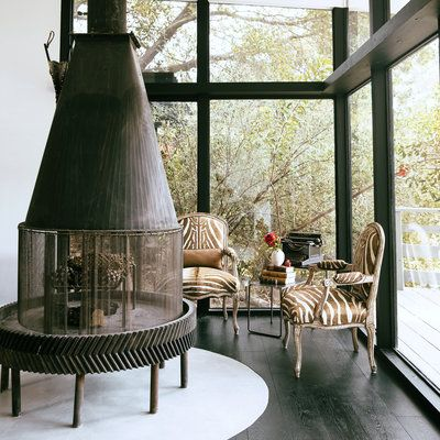 Living room: The home's original owners built the fireplace using a gear from an oil rig as the base and a sawdust collector from a factory as the hood.