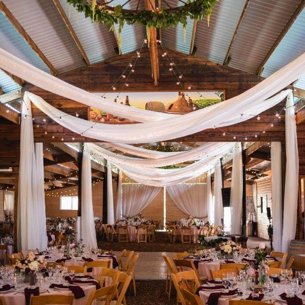 Barn wedding with drapes. Image: Instagram/thunderridgeranchvenue #barnwedding