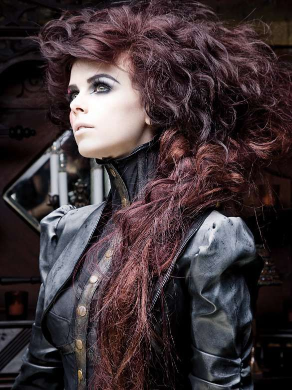 Love,love,love this exaggerated hairstyle..in long,black cherry,curled hair.With a smokey eye and pale lip makeup.I want this look!