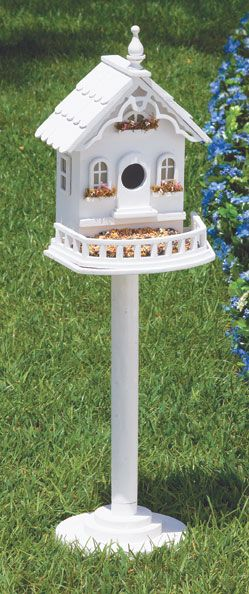 Victorian Birdhouse. One of my 2012 Spring projects - 3 to 7 white birdhouses in the new side flower garden.